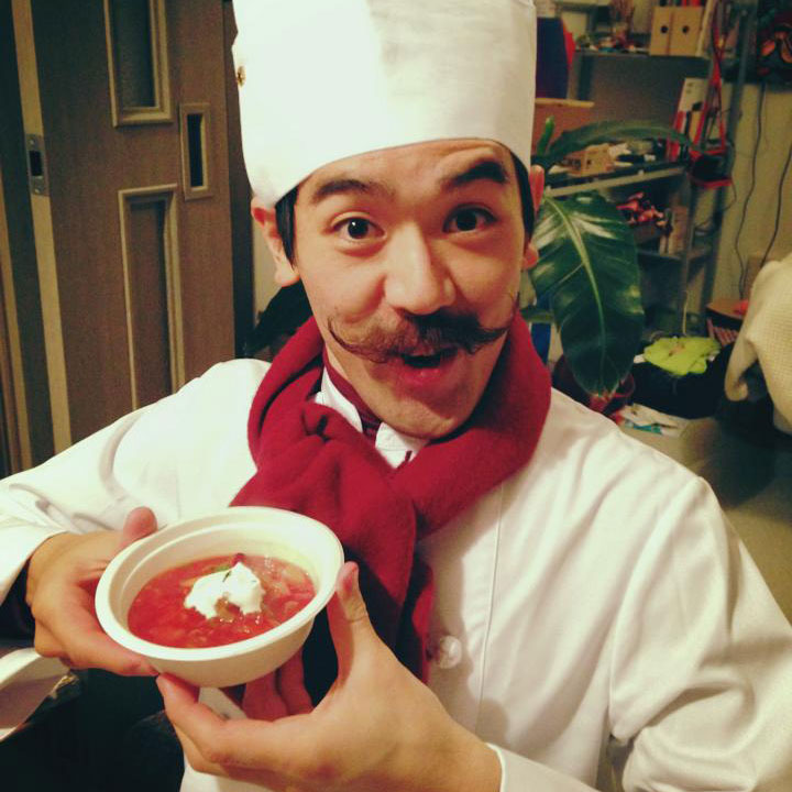 chef with mustache in hat with bowl of chef boyardee