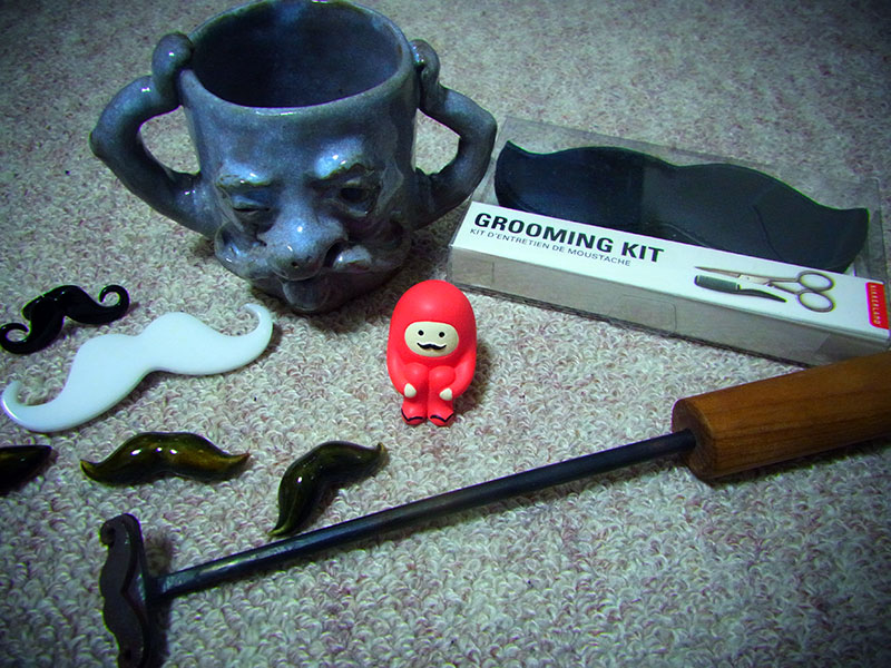 assortment of mustache goods and props