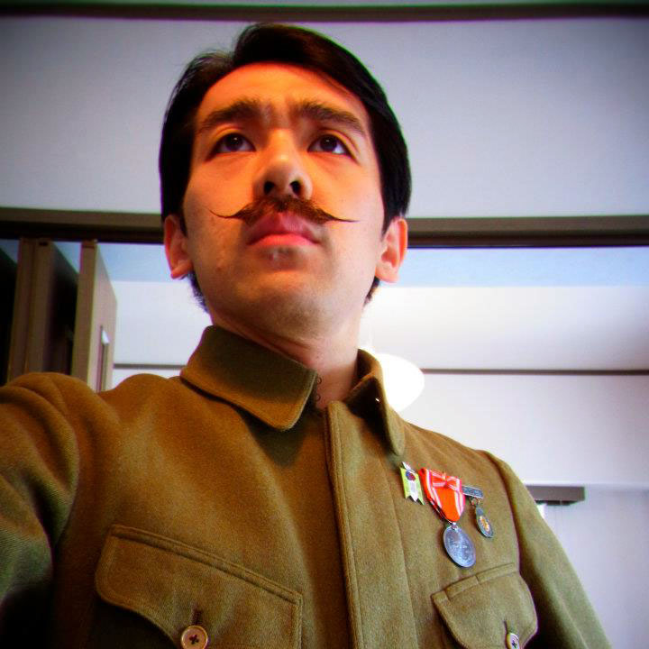 man with mustache in soldier costume
