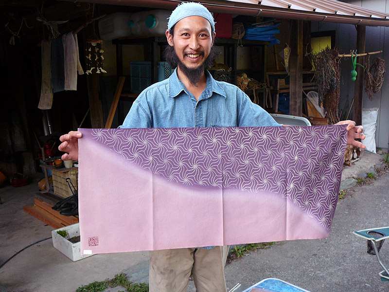 man holding handmade tenugui handdrawn japanese craft