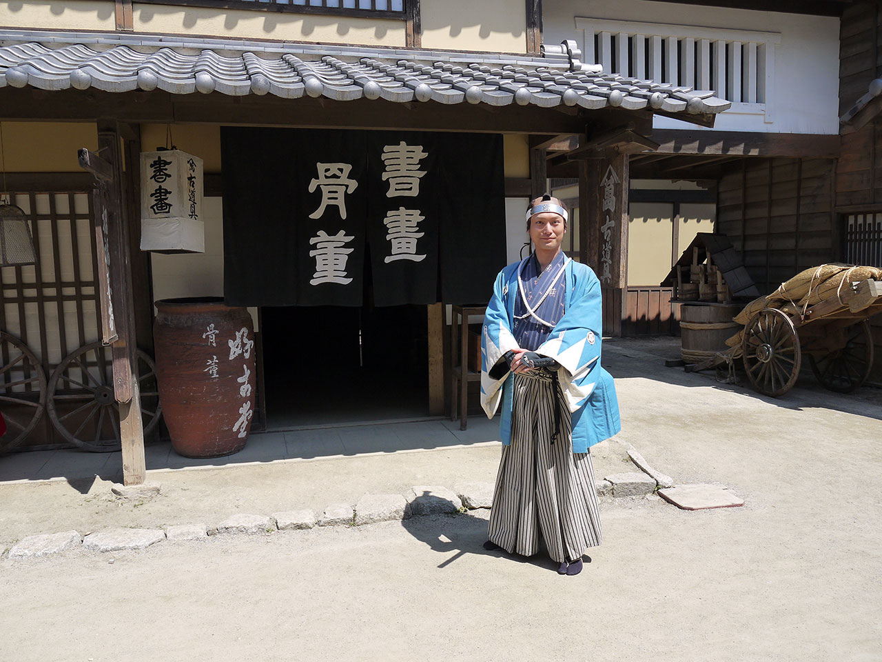 Takahiro Hotta posing on set