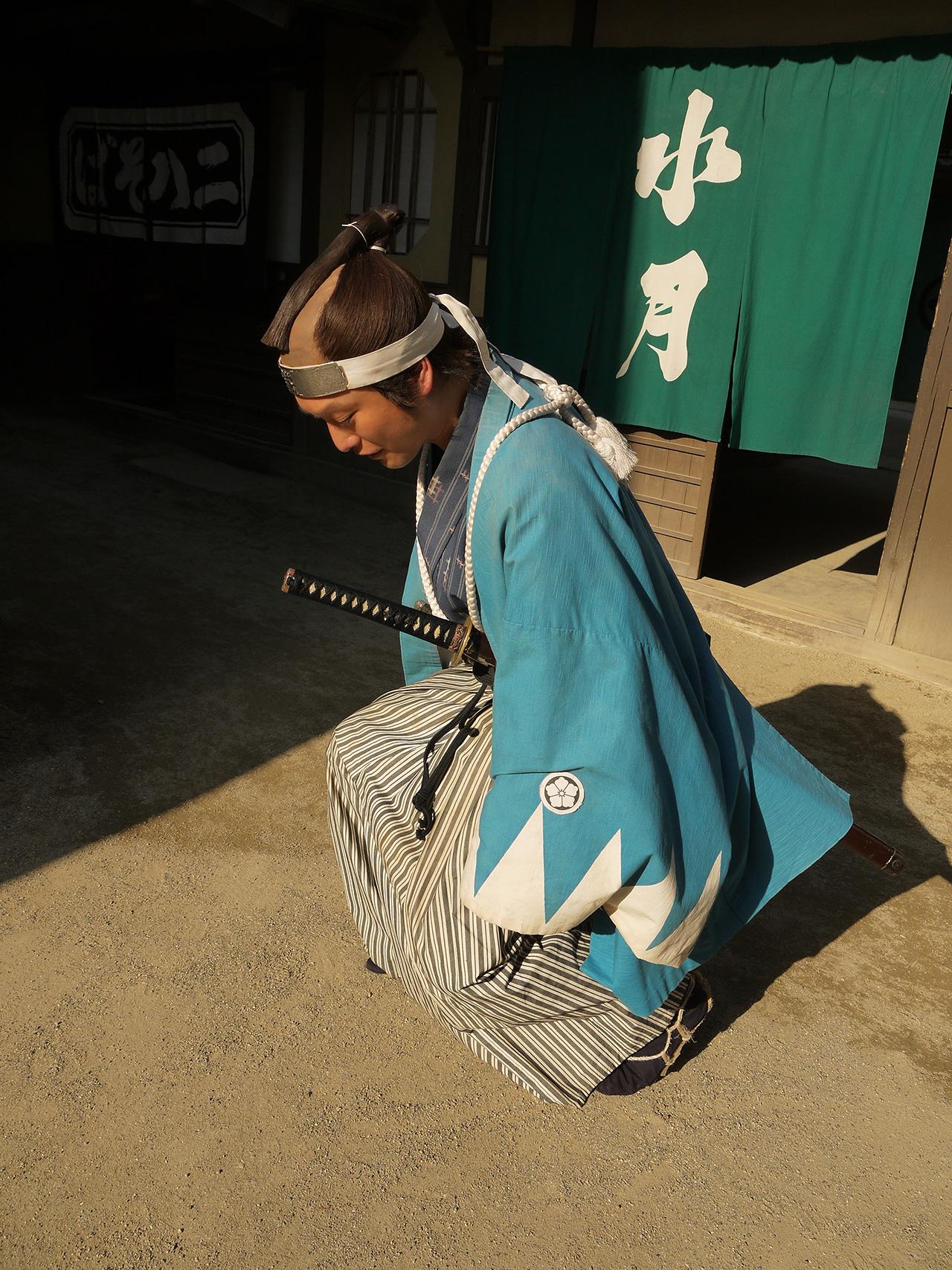 Takahiro Hotta kneeling