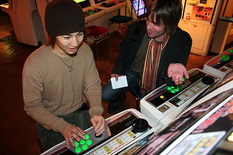 japanese teenage boy at arcade being interviewed by brian ashcraft