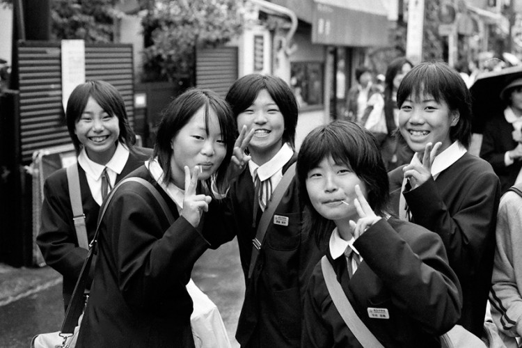 five japanese schoolgirls posing for the camera