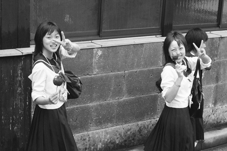 black and white photo of japanese schoolgirls on a walk