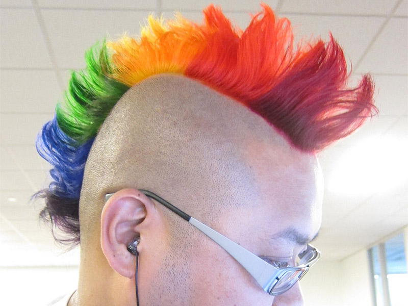 enfu with glasses with a rainbow mohawk