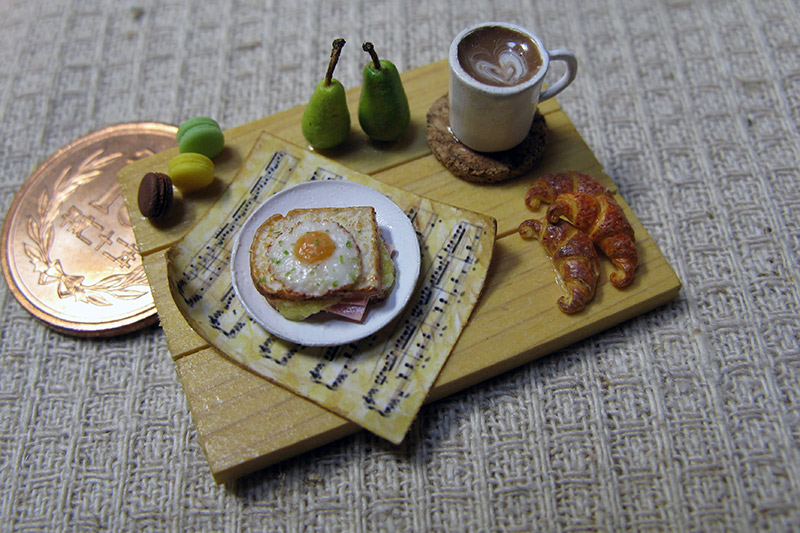 A miniature croque madame with coffee
