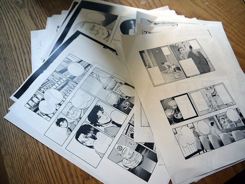 manga papers on a table