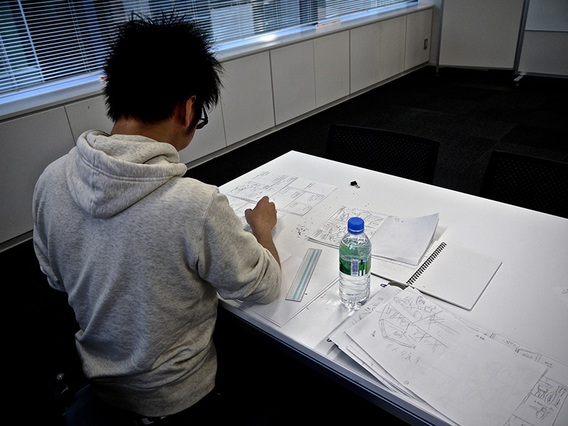 an artist working on manga at shueisha