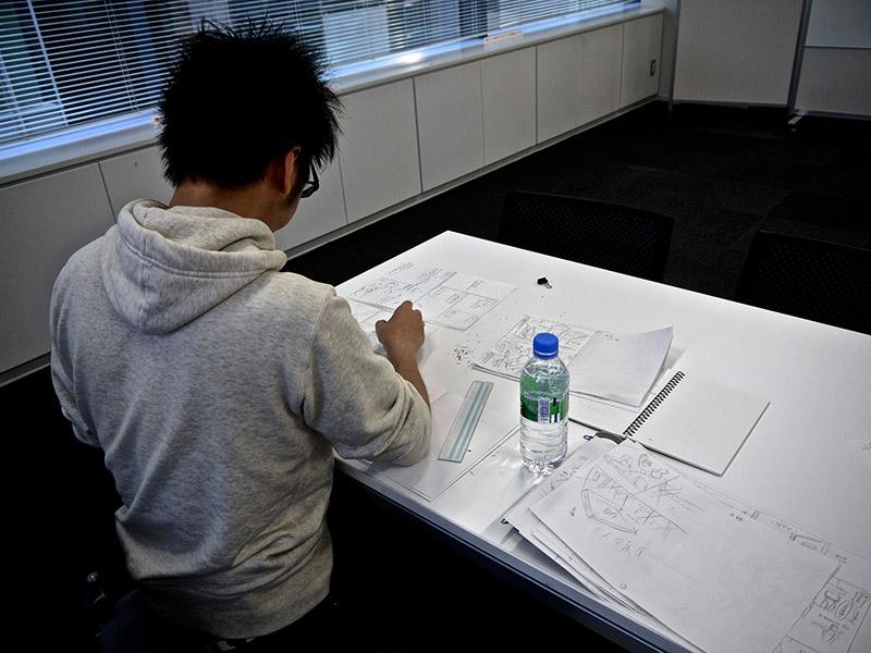 an artist working on manga at shueisha