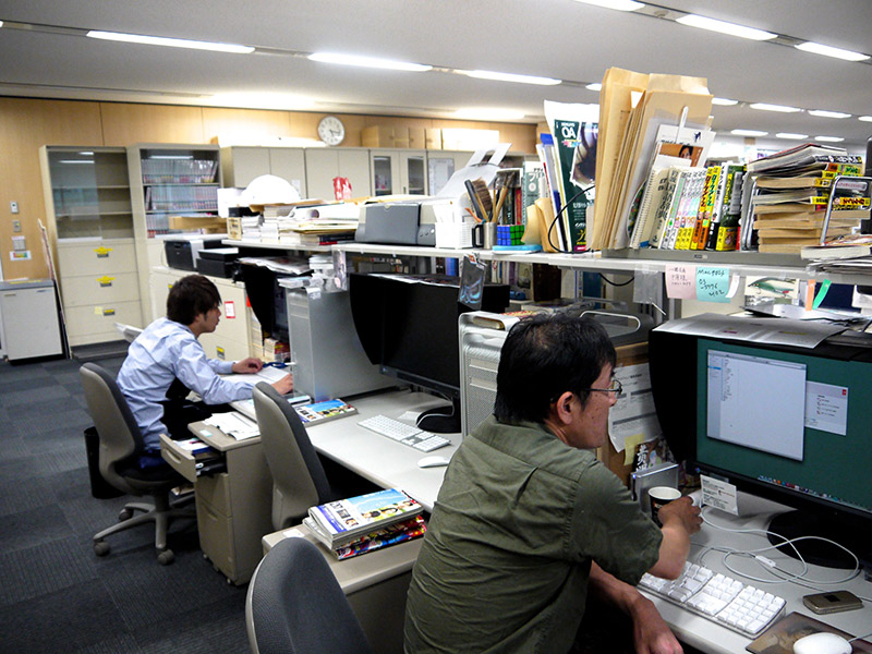 two men working at shueisha in japan