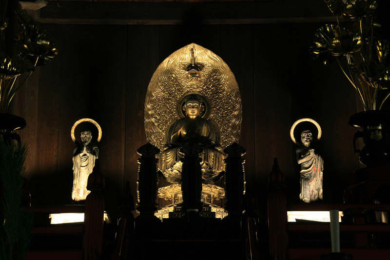 Statue of Buddha at an altar