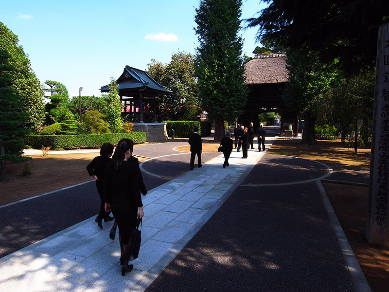 Mourners head to a Buddhist memorial service