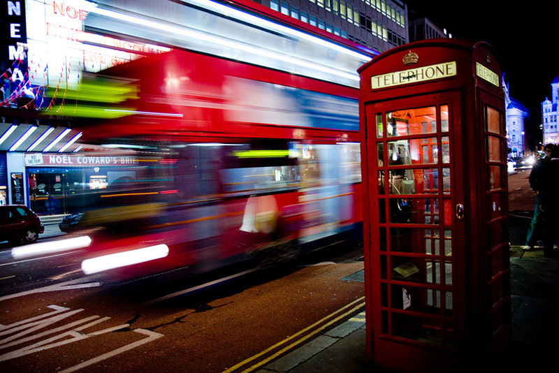 london street scene telephone booth and bus flash
