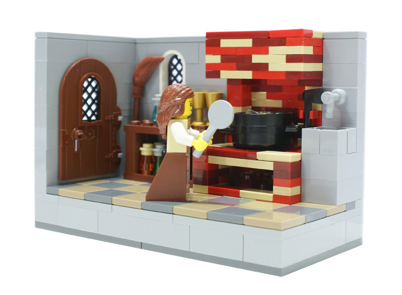 lego brick kitchen with lego housewife holding frying pan