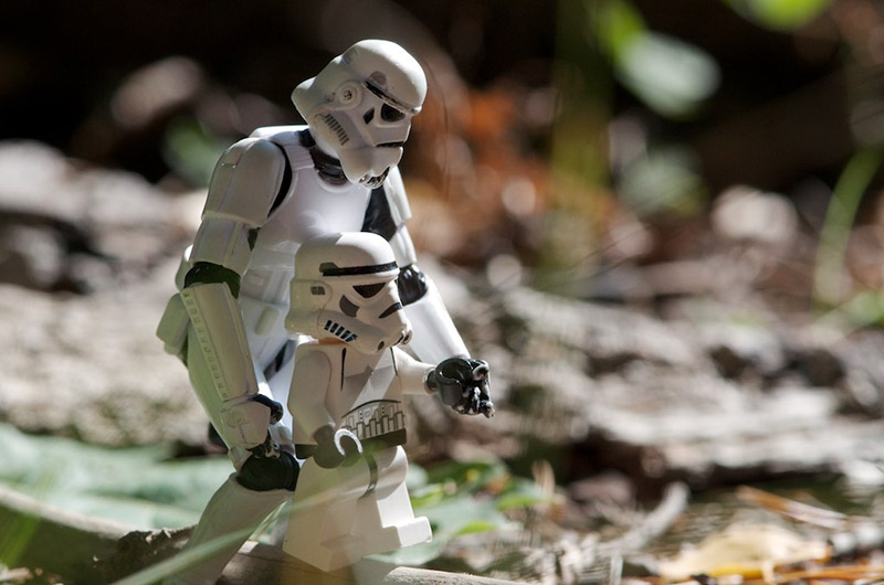 toy housewife stormtrooper holds the hand of stormtrooper offspring