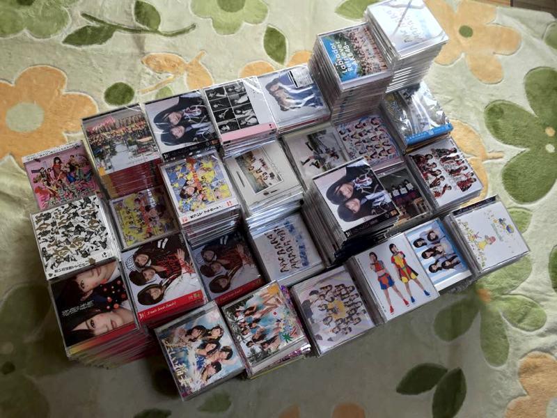 stacks of japanese music cds on carpet