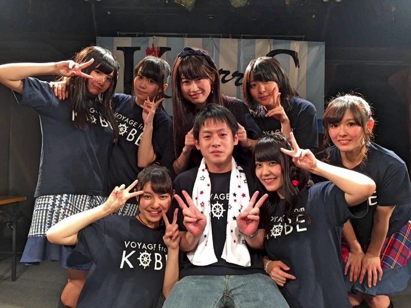 Japanese idol otaku posing with idols