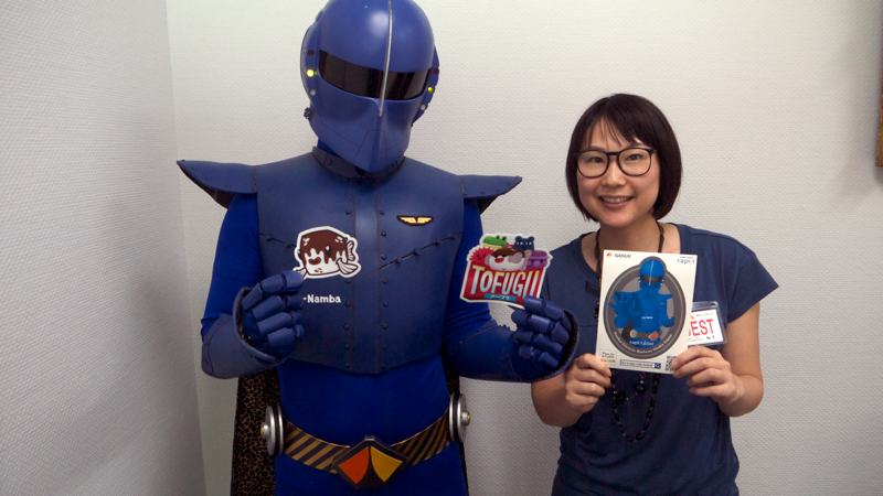 Rapi:tldier the Japanese train superhero poses with Mami from Tofugu