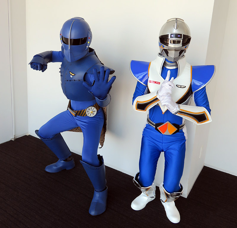 Rapi:tldier the Japanese train superhero posing with a friend