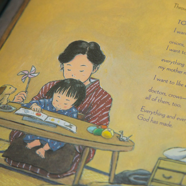 japanese woman reading to her child