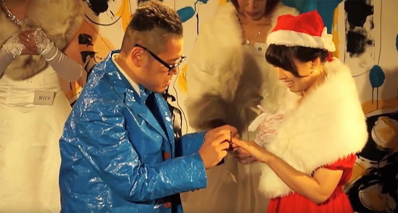 Homeless Kotani getting married in a tarp suit