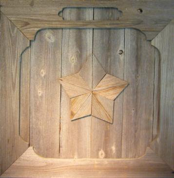 five pointed star carved on wooden door