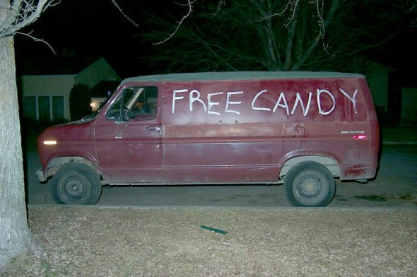a red van with the words free candy written on the side