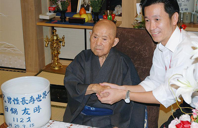 An elderly Japanese man shaking hands