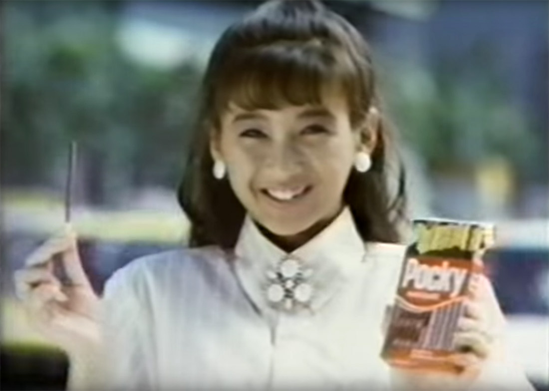 a woman eating pocky in a 1986 commercial