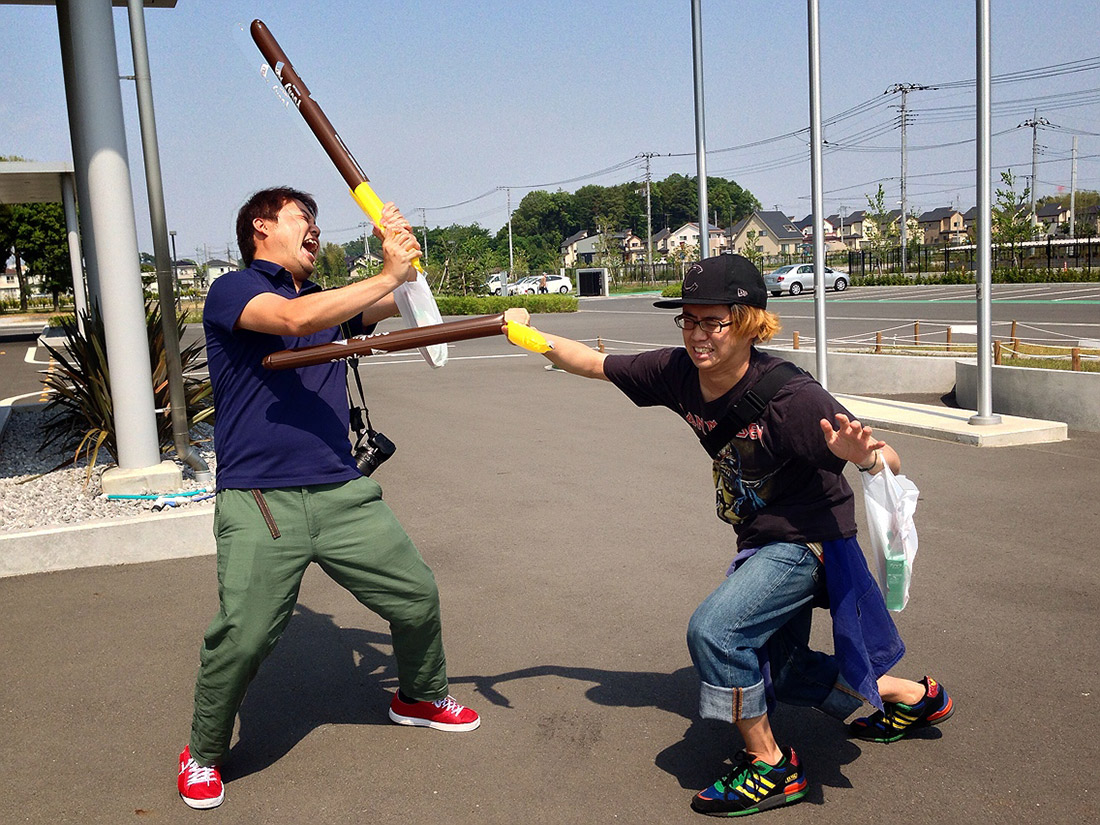 two people fighting with pocky poles