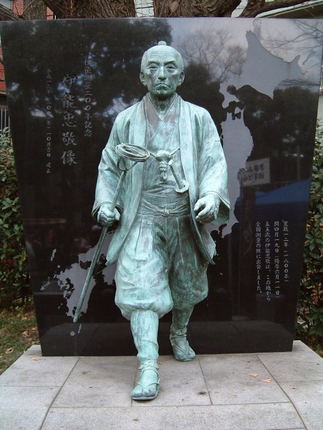 Statue of Ino Tadataka walking forward with a compass in his hand