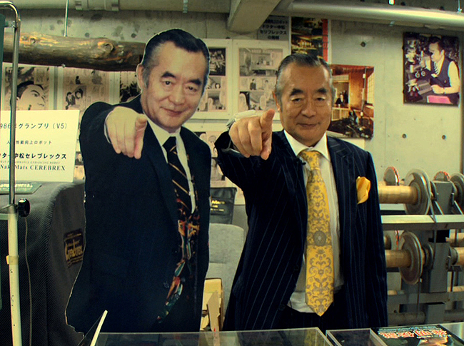 A picutre of Dr. Nakamats pointing at the camera with a cardboard version of him doing the same
