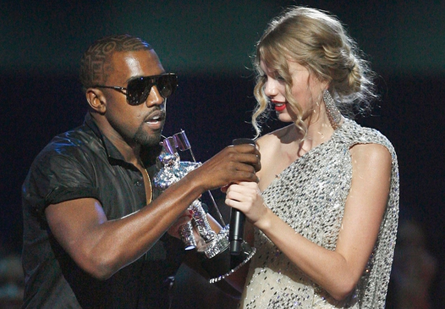 Kanye West pulling the mic away from Taylor Swift