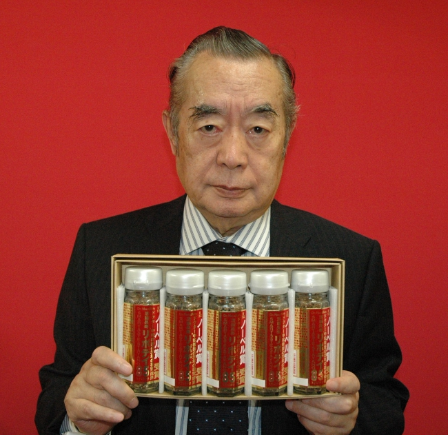 Dr. NakaMats holding a series of bottles