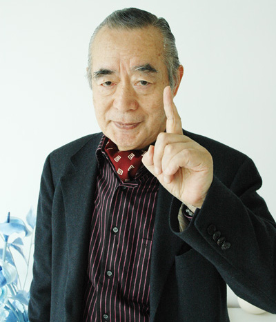 Dr. NakaMats holding one finger up to the camera