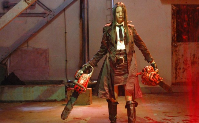 woamn holding two chainsaws in weird japanese movies