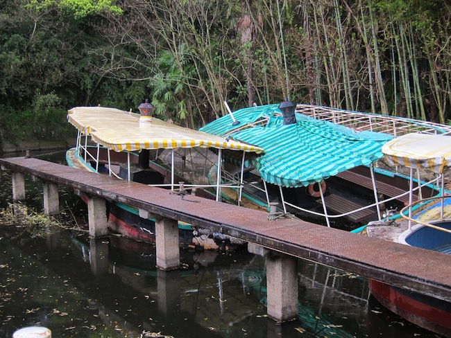 Rusty boats at the abandoned Japanese amusement park Nara Dreamland