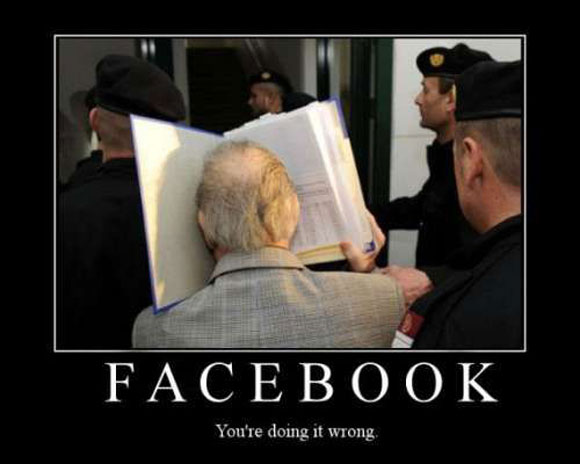 Man smashing his face into a book with the caption: Facebook, you're doing it wrong