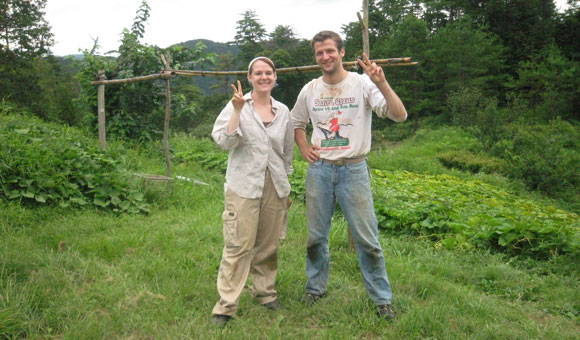 WWOOF farmers making a peace sign