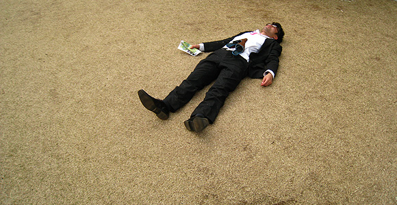 man in suit about to die from karoshi