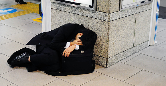 Man in suit collapsed on train station floor