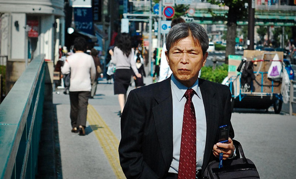 An elderly Japanese businessman on the street