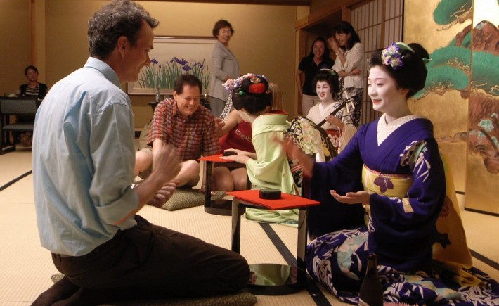 Maiko plays drinking games with a guest in Japan