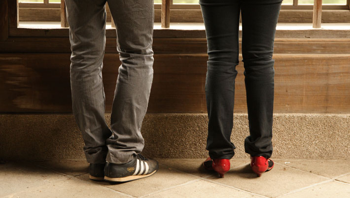 A shot of a young couple's shoes