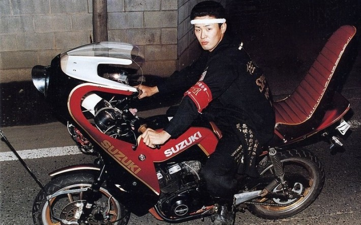 Japanese bang member on suzuki motorcycle