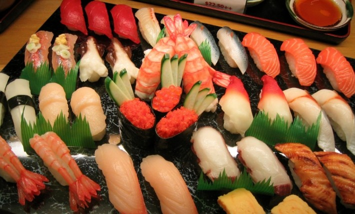 variety of colorful japanese sushi arranged on tray