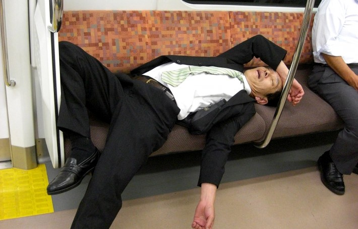 salaryman in suit asleep on train after too much sake