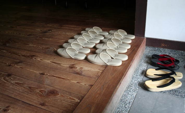 A Japanese entryway with a row of house slippers
