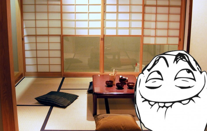 Japanese dining room with cushions and dishes left out with trollface overlaid